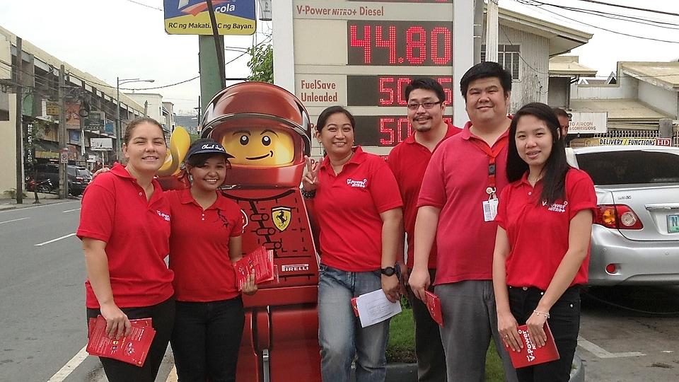 Ruel and colleagues dressed in Shell red t-shirts with a lifesize LEGO model