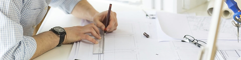 young architect drawing something on paper