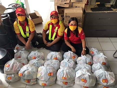 Baliuag staff excitedly prepare relief packs purchased using collected tips to purchase their donation