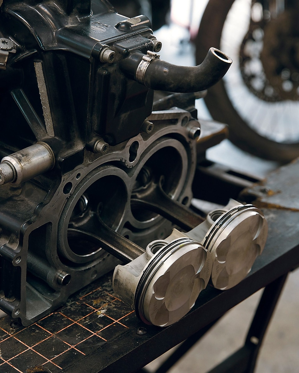 image of a parked motorcycle focusing on the pistons