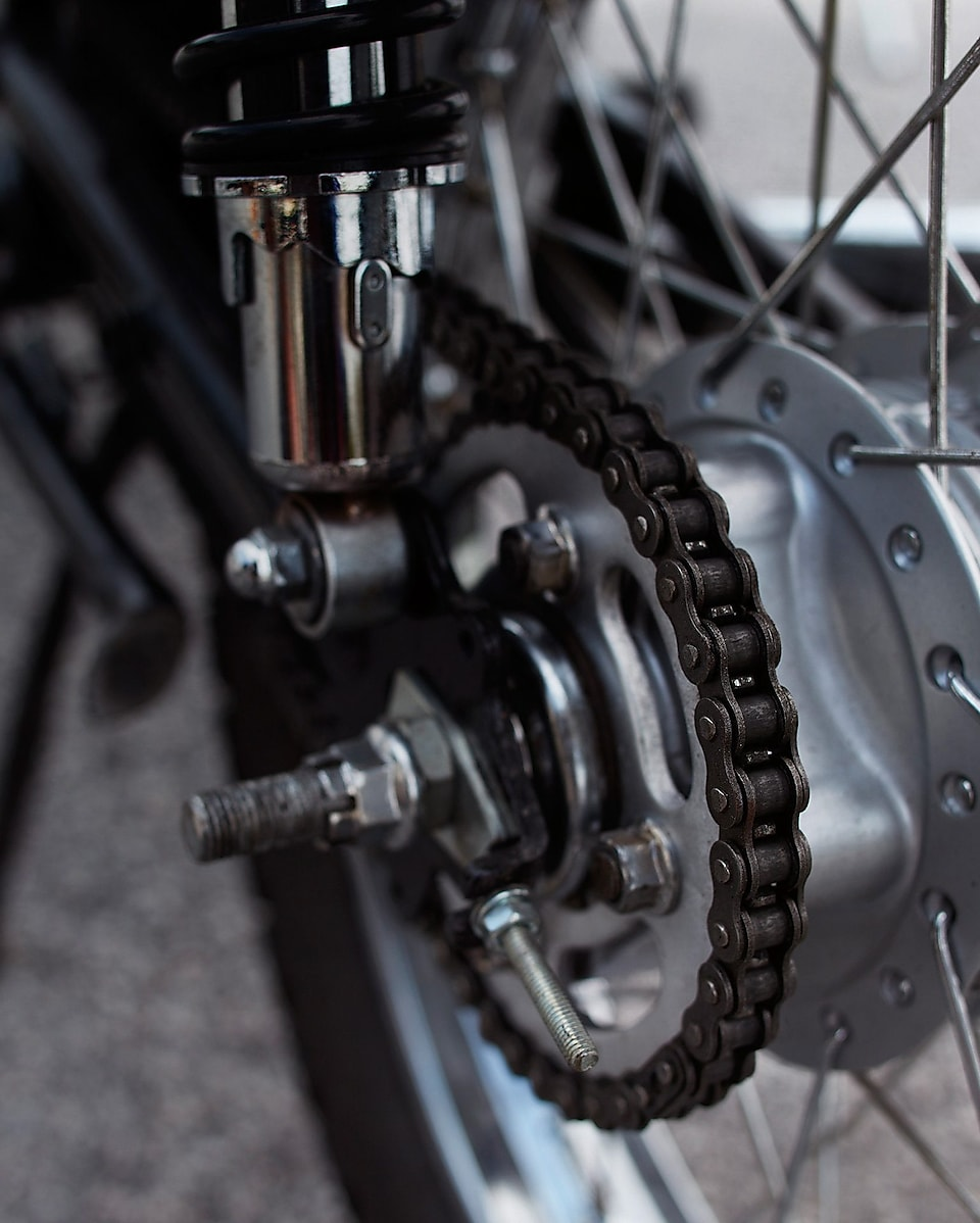 a motorcycle chain attached to the back wheel