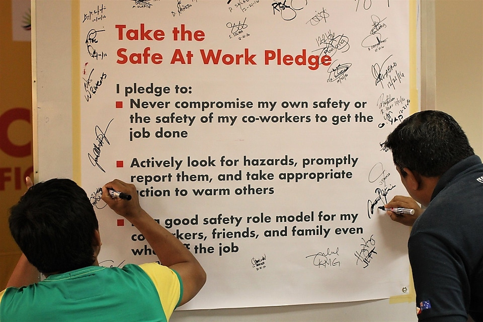 Participants sign as part of their commitment in taking safety a part of their everyday lives