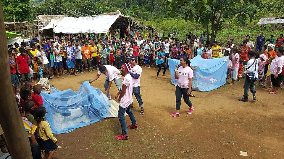 Locals participating in malaria day activities